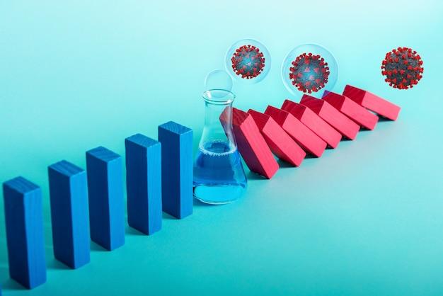 Концепция пандемии коронавируса covid19 с падающей цепью, как игра в домино. заражение и прогрессирование инфекции остановлены лечением медицинских исследований. голубая стена