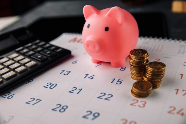 債務の概念。きれいな白いカレンダーを投げることによって