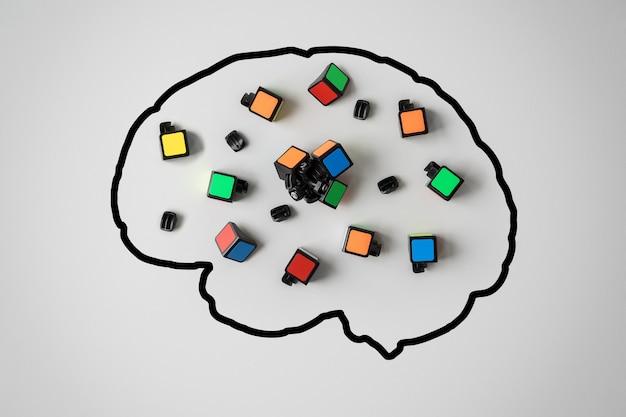 メンタルヘルスの概念。灰色の背景に壊れた難問を持つ人間の脳のシルエット。