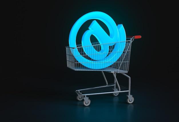 オンラインショッピングの概念。黒のショッピングカートに横たわっている大きな青い@記号。 3dレンダリング