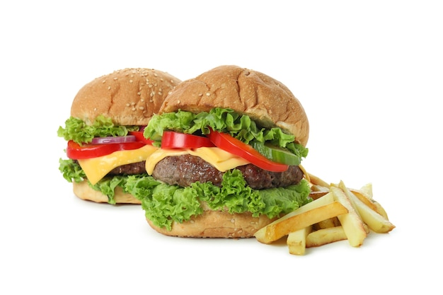 白い背景で隔離のハンバーガーとおいしい料理の概念