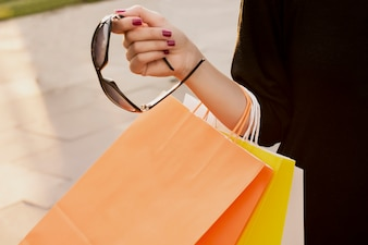 Concept of woman shopping and holding bags