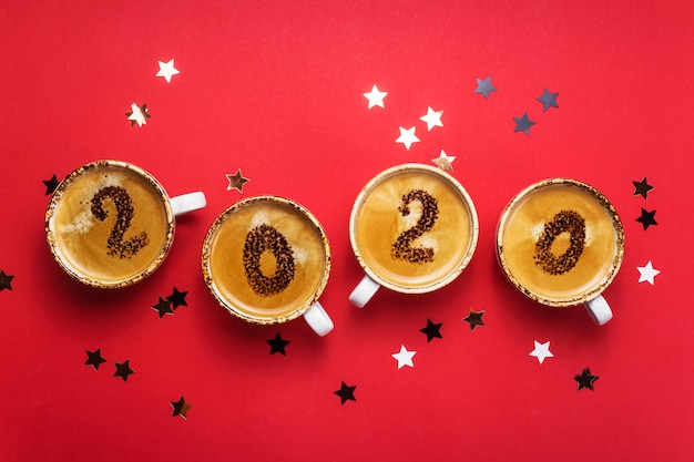The concept of the onset of the new 2020 is drawn on cups of coffee