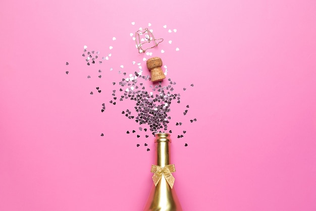 Concept of opening an expensive golden champagne bottle dedicated to the celebration