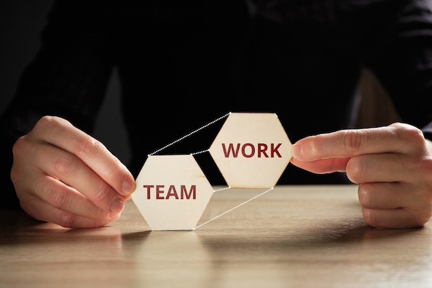 The concept of organizing teamwork in business on abstract blocks.