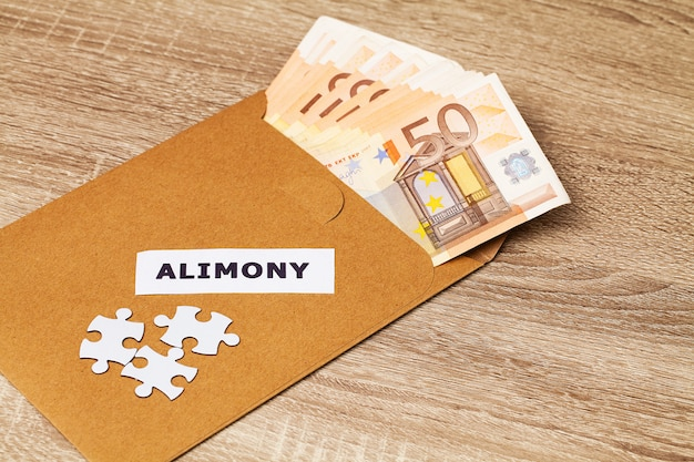 Concept of paying for the elements, money in a paper envelo