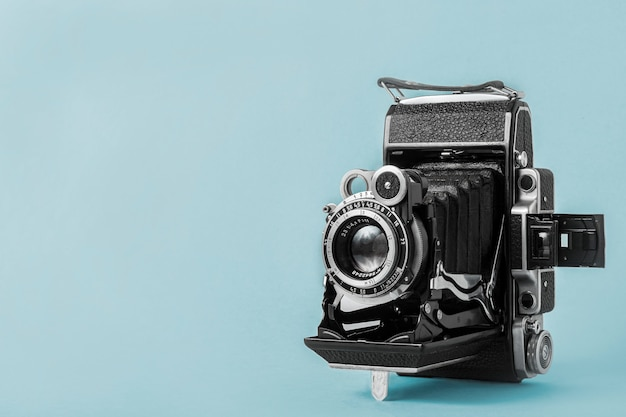 Concept for a photographer, old photo equipment, minimalistic style. old retro vintage camera