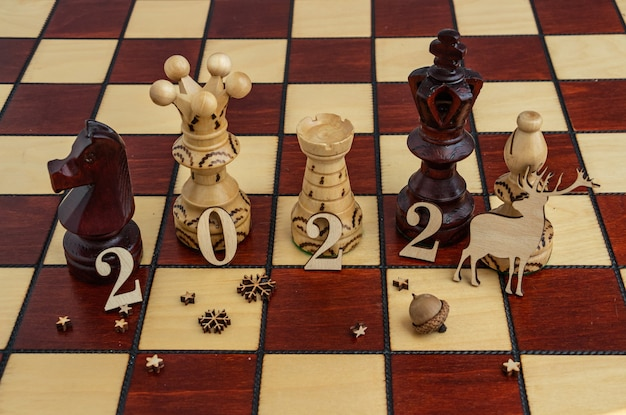 Concept photography new year composition on a chessboard flat lay copy space