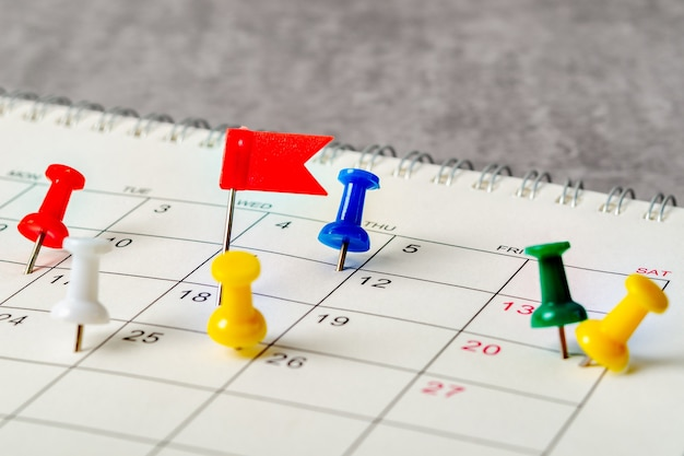 The concept of planning and deadline with push pin on calendar date.