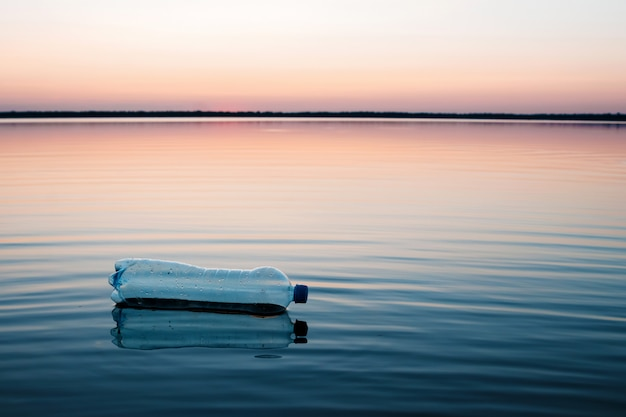 Concept of pollution, creative. a plastic bottle floating in the ocean