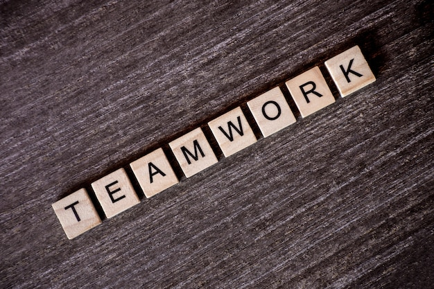 Concept presented by crossword with words teamwork with wooden cubes