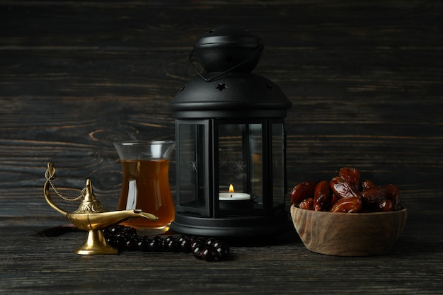 Concept of ramadan with dates and accessories on wooden surface