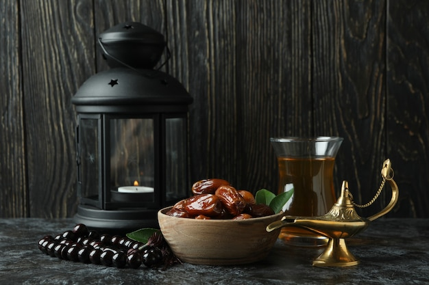 Concept of ramadan with food and accessories against wooden table