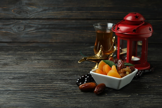 Concept of ramadan with food and accessories on wooden table