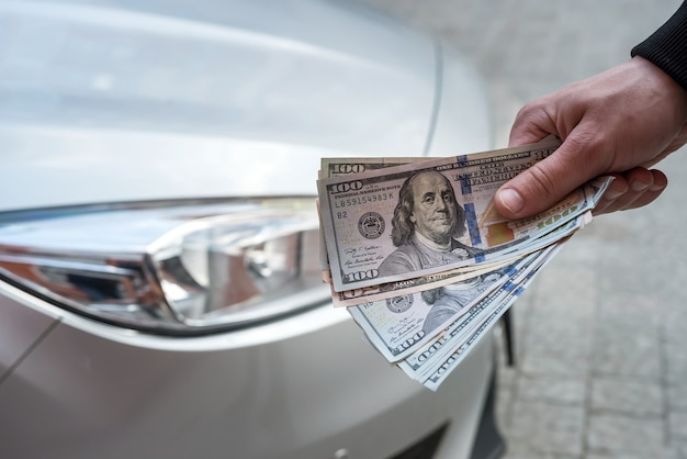 Concept of rent or buy new car finance concept dollar in male dollar