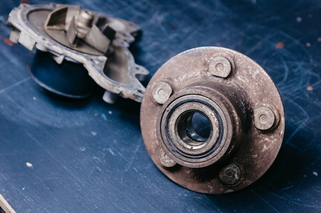 Concept of replacing the old rusty hub and wheel bearing car dismantling