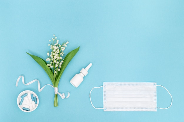 Concept of seasonal allergies with nasal spray and pills