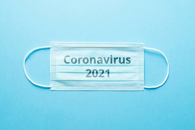 Concept of the second wave of coronavirus covid-19 on a medical mask in 2021.