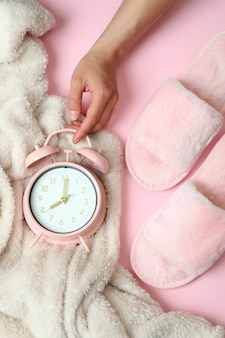 Concept of sleep routine accessories on pink background