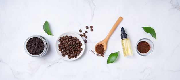 Concept spa flat lay with natural ingredients for home body coffee scrub with oil