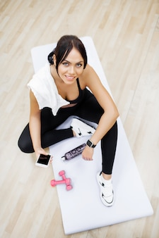 Concept of sport and healthy lifestyle. cute brunette working out at a gym