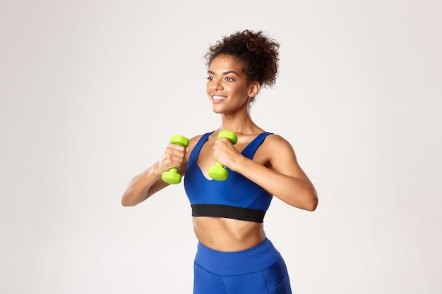 Concept of sport and workout. healthy beautiful african-american sportswoman in blue gym outfit