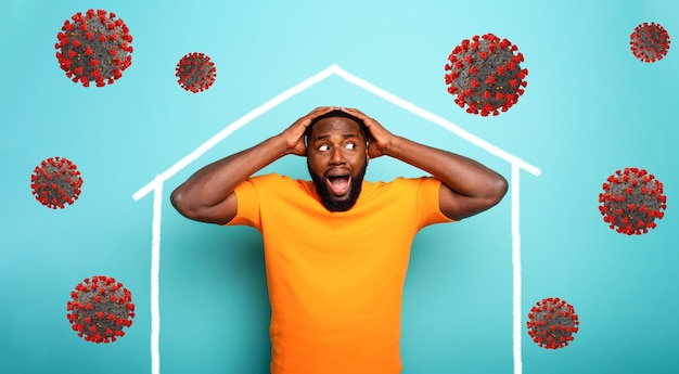 Concept of stay at home message with a man inside his house and around outside coronavirus
