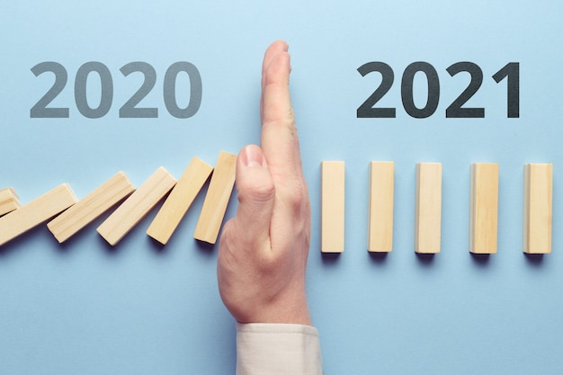 The concept of stopping the crisis, pandemic, financial problems in 2020. successful 2021 new year.