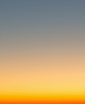 Concept of summer holidays, abstract blur sunset gradient sky background