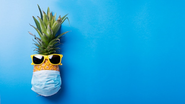 Concept of summer vacation with pineapple and medical musk