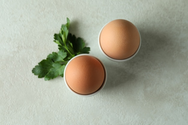 Concept of tasty breakfast with boiled eggs, top view
