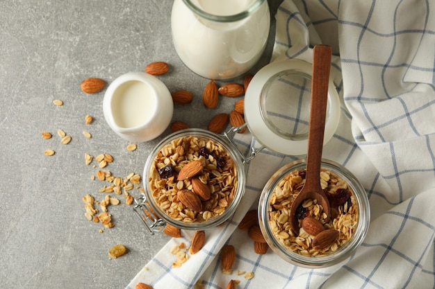 Concept of tasty breakfast with granola on gray background