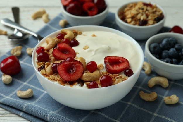 Concept of tasty breakfast with yogurt, close up