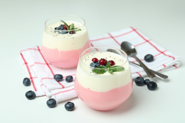 Concept of tasty breakfast with yogurt on white background