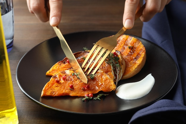Concept of tasty eating with baked pumpkin .