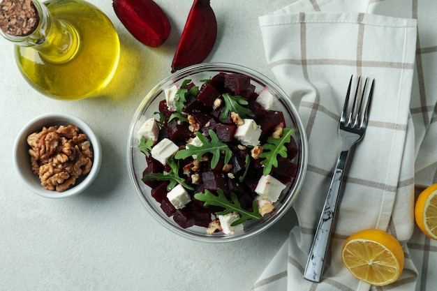 Concept of tasty eating with beet salad on white textured