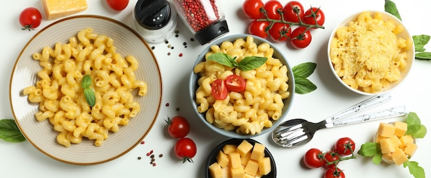 Concept of tasty eating with macaroni with cheese on white background