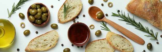 Concept of tasty eating with olive oil on white surface