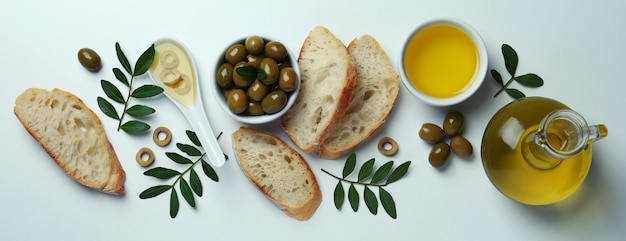 Concept of tasty eating with olive oil on white