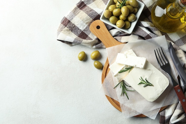 Concept of tasty food with feta cheese on white textured