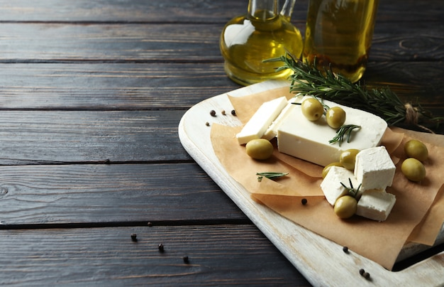 Concept of tasty food with feta cheese on wooden
