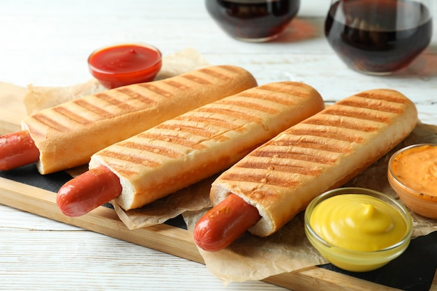 Concept of tasty food with french hot dog