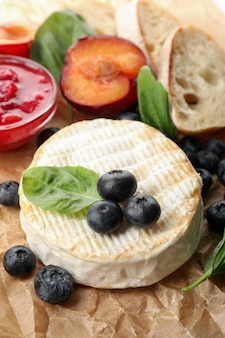 Concept of tasty food with grilled camembert, close up.