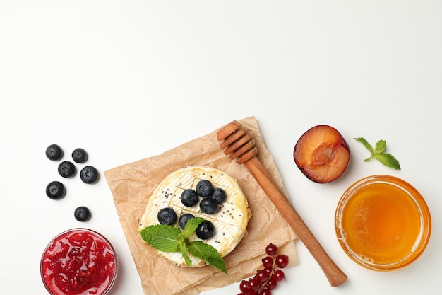 Concept of tasty food with grilled camembert on white background.