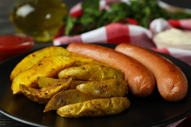 Concept of tasty meal with potato wedges, close up