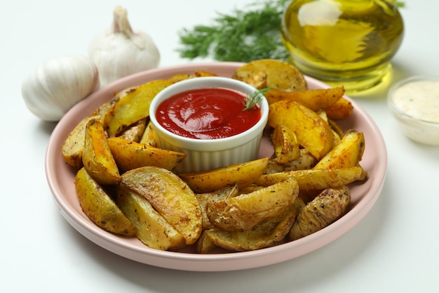 Concept of tasty meal with potato wedges on white