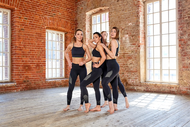 Concept teamwork, movement life, sport, beauty, success. beautiful fitness girls in a fitness room, having fun before a workout.