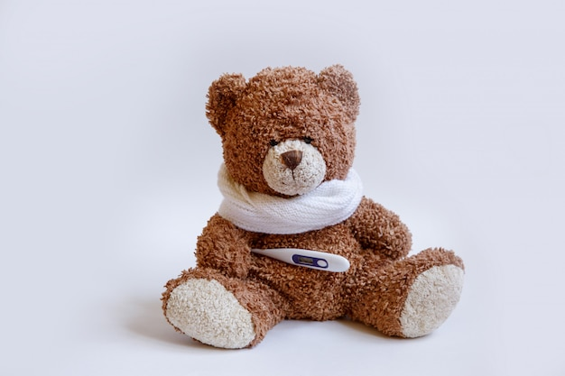 Concept teddy bear childhood diseases on white background