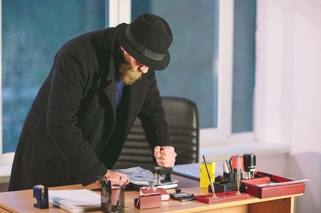 Concept. thief steals in the office. spy in the office.