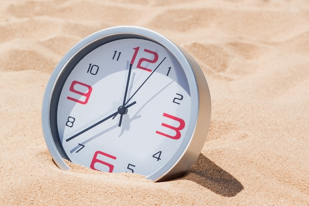Concept time deadline. hours on the beach.